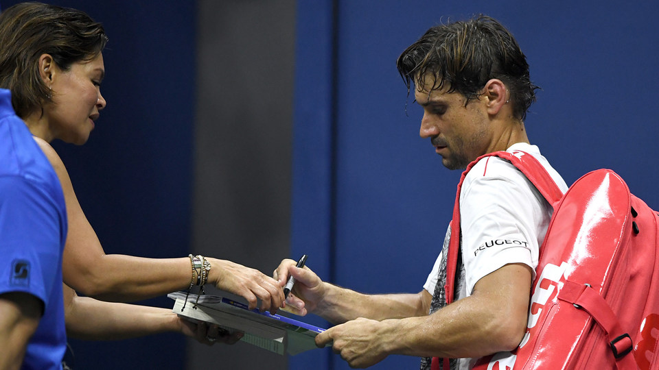 August 27, 2018 - David Ferrer signs autographs during the 2018 US Open.