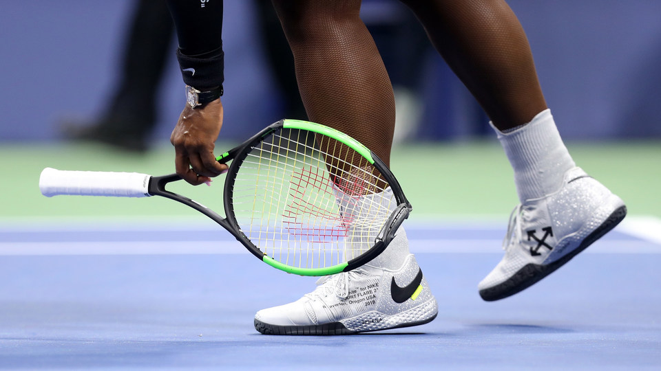 September 8, 2018 - Serena Williams picks up her racquet after she slammed it into the ground out of frustration in action against Naomi Osaka in the women's singles final at the 2018 US Open.